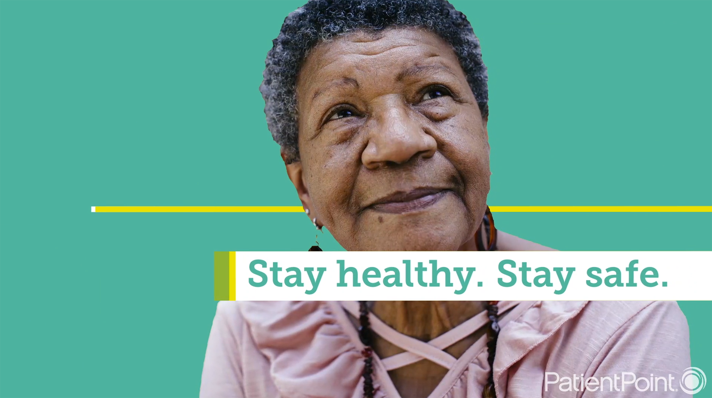 "An older woman looks up while the words ""Stay Healthy. Stay Safe."" appear on screen."