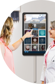 Doctor and patient engaging with interactive exam room display.
