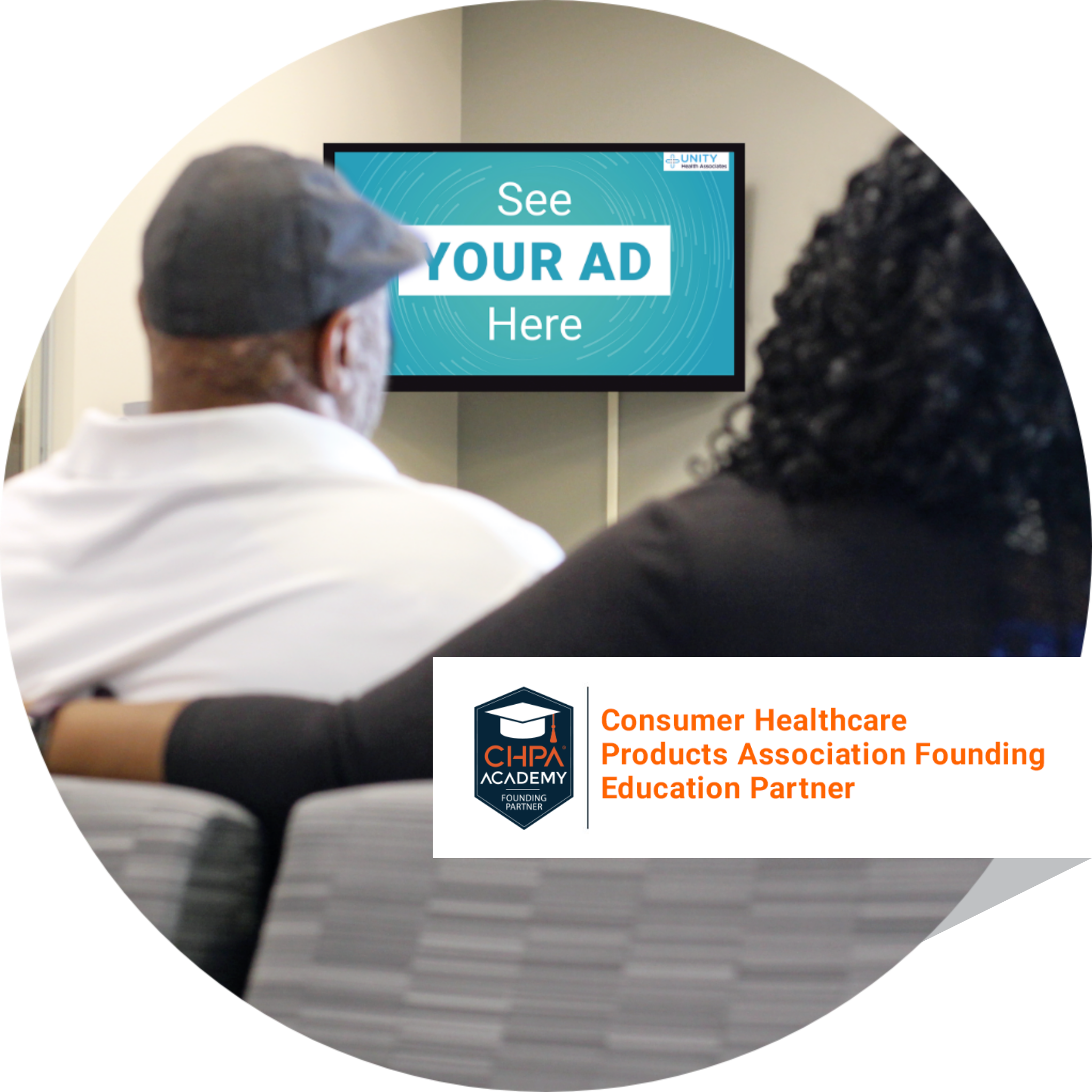 Man and woman sitting in waiting room watching TV screen with sponsor ad on it