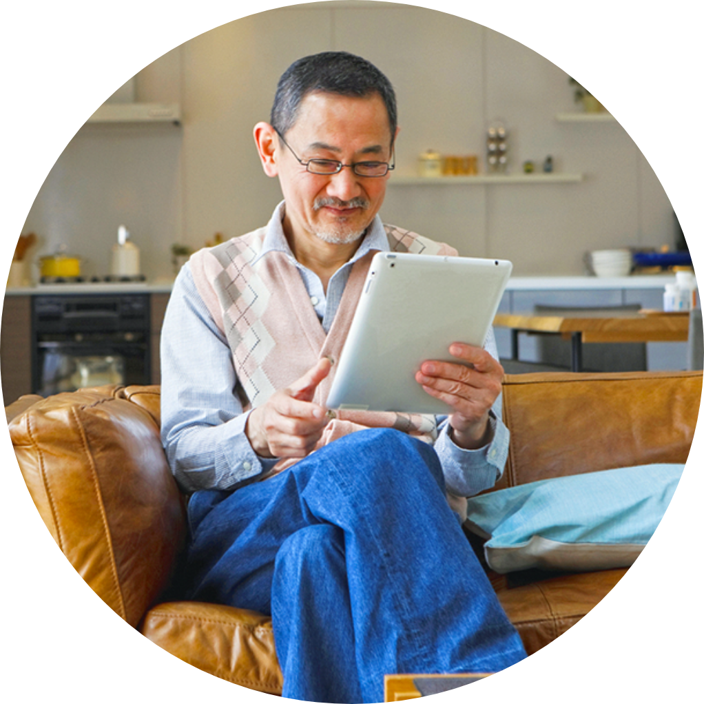 Man at home with a tablet looking at a local healthcare business listing.